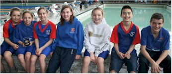 There were 7 Sutton & Cheam swimmers, sitting on the wall!